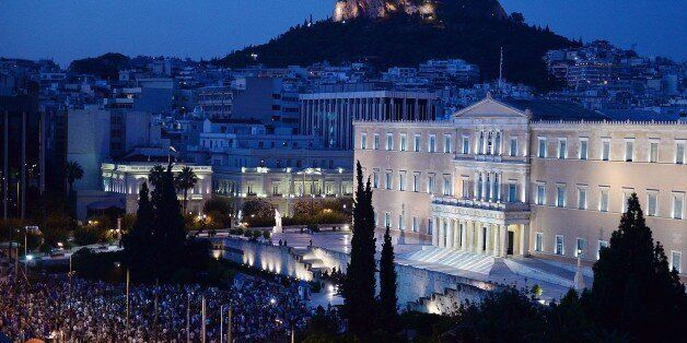 Pro-European Union protesters gather in front of the Greek parliament in Athens during a demonstration by a ' we stay in Euro