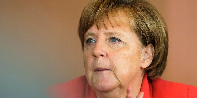 German Chancellor Angela Merkel leads the weekly cabinet meeting at the chancellery in Berlin, Wednesday, July 8, 2015. (AP P