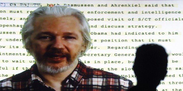 Founder of Wikileaks Julian Assange speaking from the Ecuadorean embassy in London appears on a screen as he gives a video co
