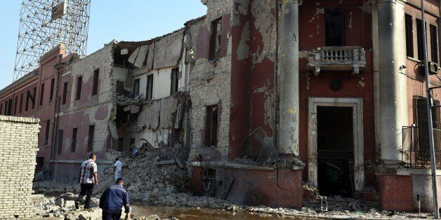 A general view shows the destroyed facade of the Italian consulate building following a powerful bomb explosion, killing one