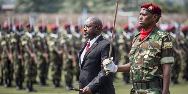 Burundi President Pierre Nkurunziza (C) reviews troops after arriving for the celebrations marking the 53rd anniversary of th