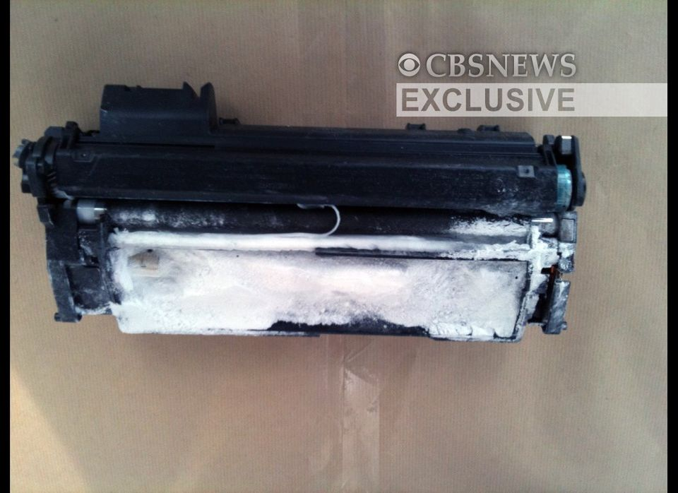 This image provided by CBS News shows a printer toner cartridge with wires and powder found aboard a plane in East Midlands,