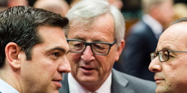 Greek Prime Minister Alexis Tsipras, left, speaks with European Commission President Jean-Claude Juncker, center, and French