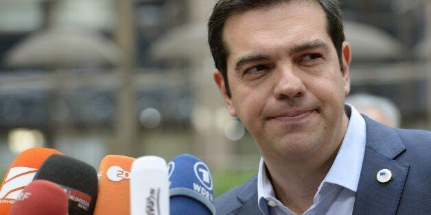 Greek Prime Minister Alexis Tsipras arrives for a meeting of the leaders of the 19 countries that use the euro, in Brussels o