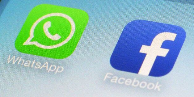 FILE - This Feb. 19, 2014 file photo shows WhatsApp and Facebook app icons on a smartphone in New York. One sign of the growi