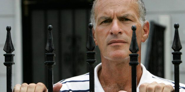 DePaul University professor Norman Finkelstein looks over a fence outside his home in Chicago, Wednesday, Sept. 5, 2007. Fink