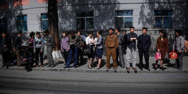 North Koreans wait in line for a city trolley, Monday, May 4, 2015 in Pyongyang, North Korea. The city trolley is one of the