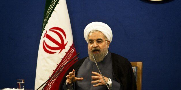 Iranian President Hassan Rouhani speaks during a press conference in Tehran on June 13, 2015. There are still 'many differenc