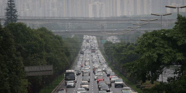 CHENGDU, CHINA - JUNE 30:  Commuter traffic flows from a skyline of apartment buildings on  June 30, 2015 in Chengdu, China.