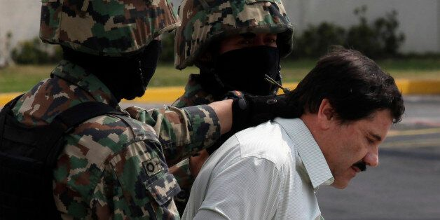 "FILE - In this Feb. 22, 2014, file photo, Joaquin ""El Chapo"" Guzman, in handcuffs, is escorted to a helicopter by Mexican nav"
