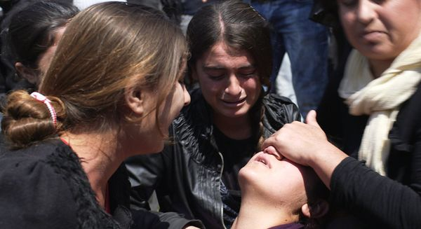 A young Yazidi women suffers a post traumatic collapse during a protest in a camp for displaced people