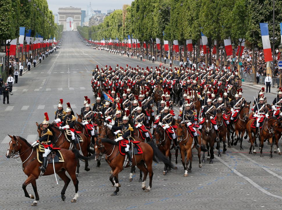 Mounted Republican Guards ride down the Champs-Elysees.  (AP Photo/Michel Euler)