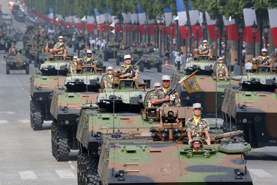 French tanks of the Tirailleur Battalion drive down the Champs-Elysees. (AP Photo/Michel Euler)