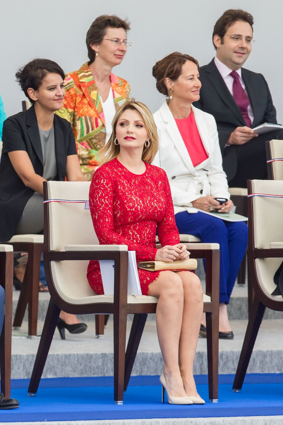 Mexican first lady Angelica Rivera, center, looks at the Bastille Day parade on the Champs-Elysees. (AP Photo/Kamil Zihnioglu
