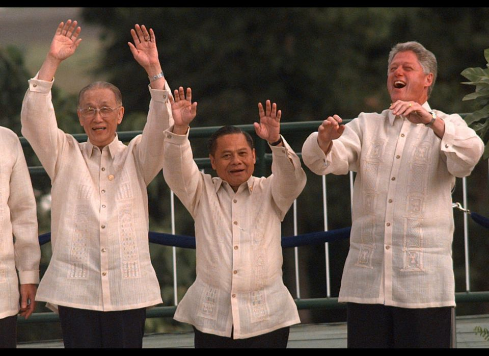 Wearing a white tieless shirts called barong tagalog, Clinton leads Pacific Rim leaders in the wave.