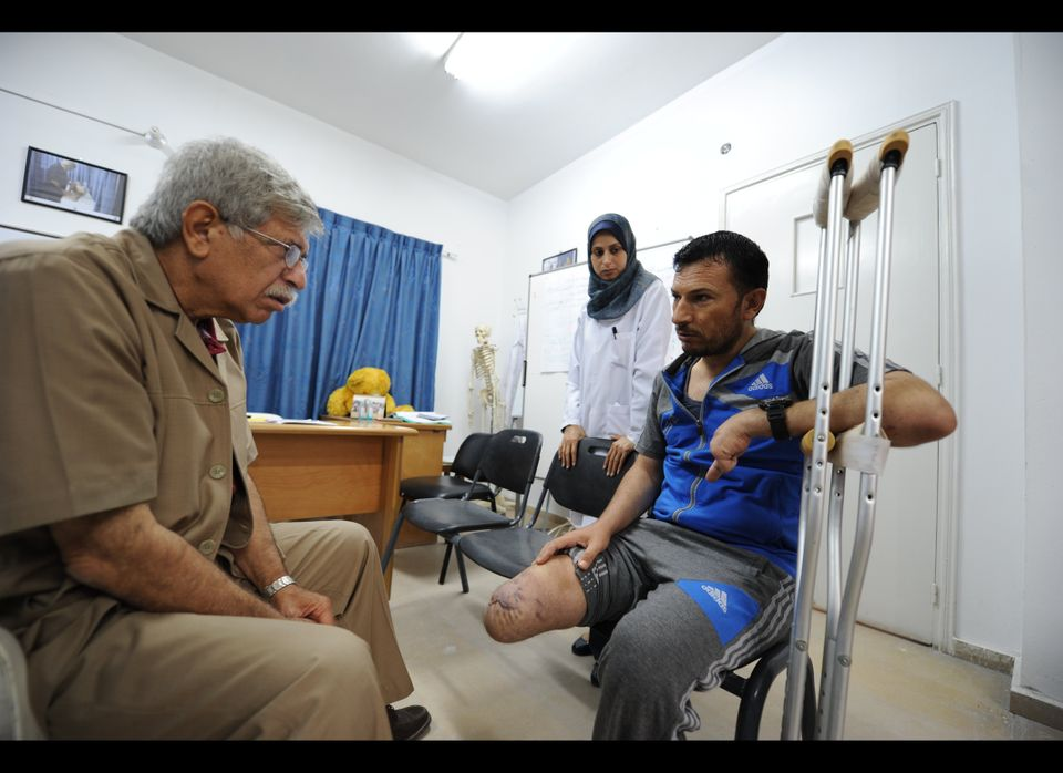 Dr Nabeel Al Shawa (left) is a consultant orthopaedic surgeon at Gaza's only prosthetic clinic in Gaza. He is here seeing Raj