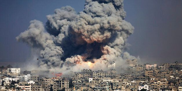 FILE - In this July 29, 2014 file photo, smoke and fire from an Israeli strike rise over Gaza City. Israel launches a pre-emp