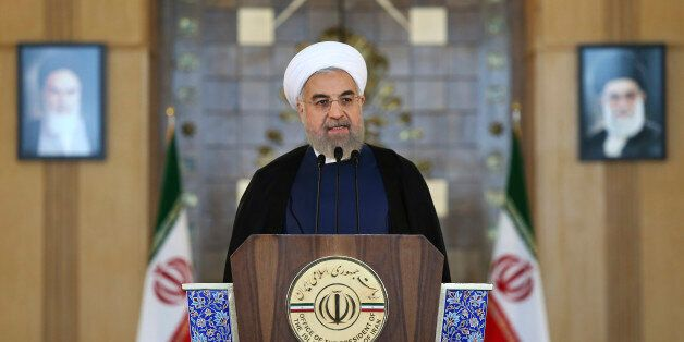 Iran's President Hassan Rouhani addresses the nation in a televised speech after a nuclear agreement was announced in Vienna,