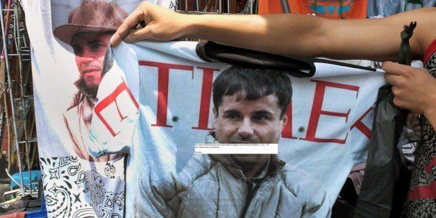 A vendor shows a t-shirt with the face of Joaquin 'El Chapo' Guzman Loera for sale in the popular and dangerous Tepito neighb