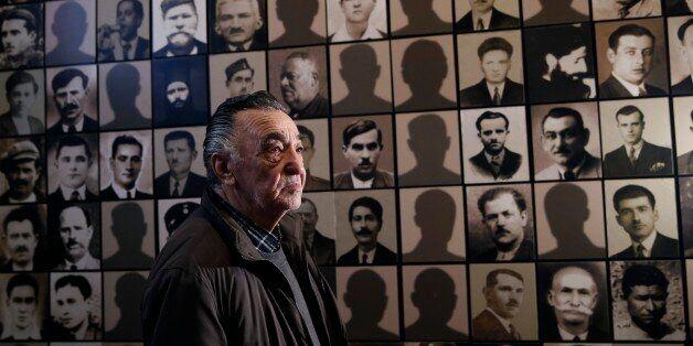 In this photo taken Saturday, March 21, 2015, Georgios Dimopoulos, 85, a survivor of the Kalavryta massacre poses for a photo