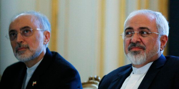 Iranian Foreign Minister Mohammad Javad Zarif and the Head of the Iranian Atomic Energy Organization Ali Akbar Salehi, left,