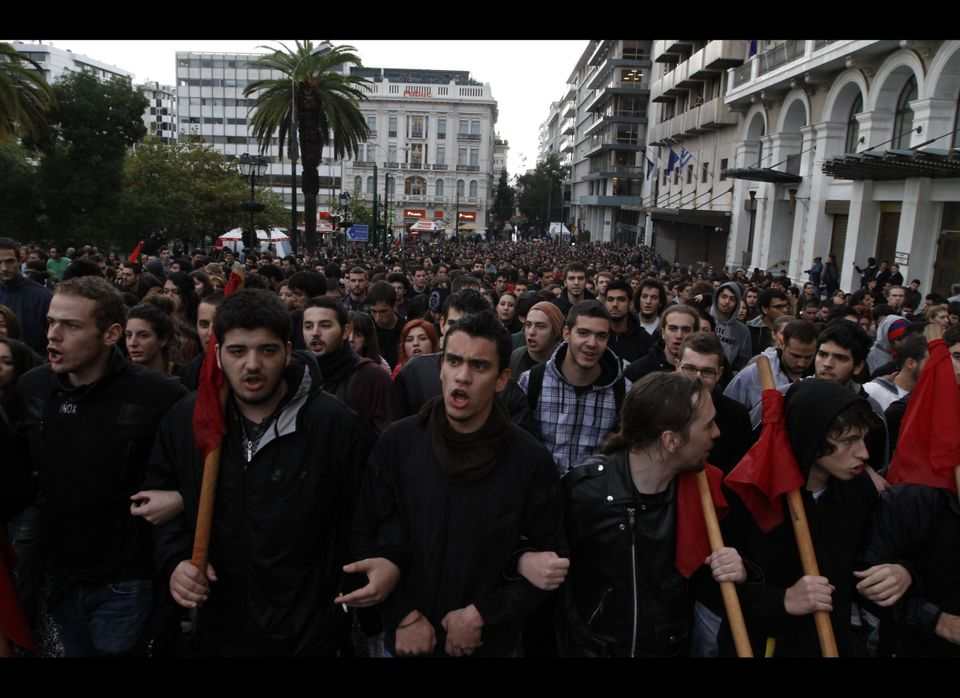 Youths hurled rocks, flares and smashed-up paving stones at police outside the U.S. Embassy in Athens on Wednesday, during a