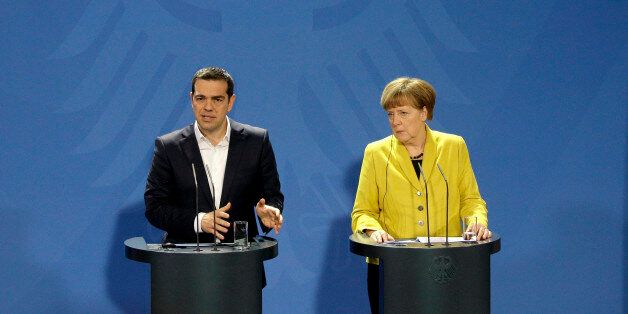 German Chancellor Angela Merkel, right, and the Prime Minister of Greece, Alexis Tsipras,  address the media during a press c