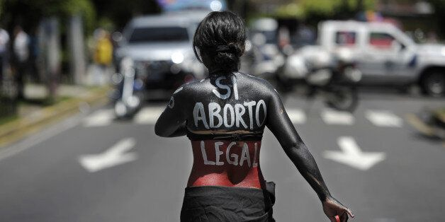 A woman participates in a march on the International Day of Action for the Decriminalization of Abortion, on September 28, 20