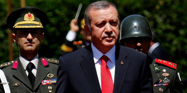 Turkish President Recep Tayyip Erdogan inspects a honor guard during a welcoming ceremony before a meeting with Turkish Cypri