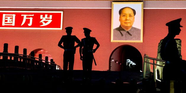 BEIJING, CHINA - JUNE 03:  Chinese Paramilitary police officers stand guard below a portrait of the late leader Mao Zedong in