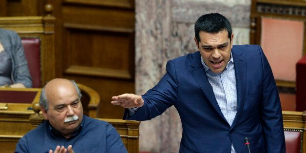 Greek Prime Minister Alexis Tsipras answers opposition questions as Minister of Interior and Administrative Reconstruction Ni