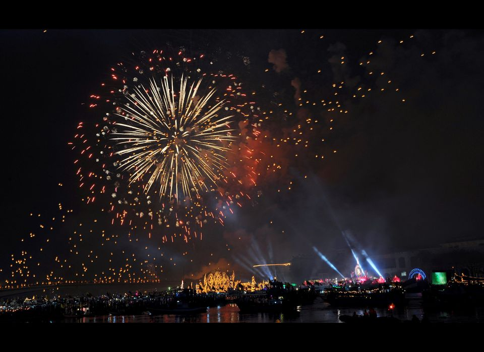 Fireworks explode over the Chaophraya river during the celebration.
