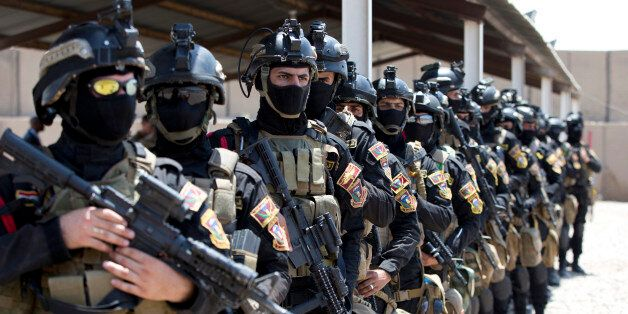 The Iraqi Counter Terrorism Service forces participate in a training exercise as U.S. Defense Secretary Ash Carter observes a