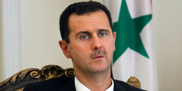 FILE - This Wednesday, Aug. 19, 2009 file photo shows Syrian President Bashar Assad during a meeting with his Iranian counter