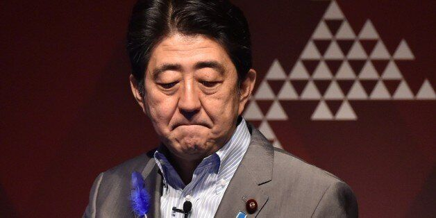 Japan's Prime Minister Shinzo Abe reacts during the economic forum Japan Summit 2015 in Tokyo on July 9, 2015. Abe on July 9