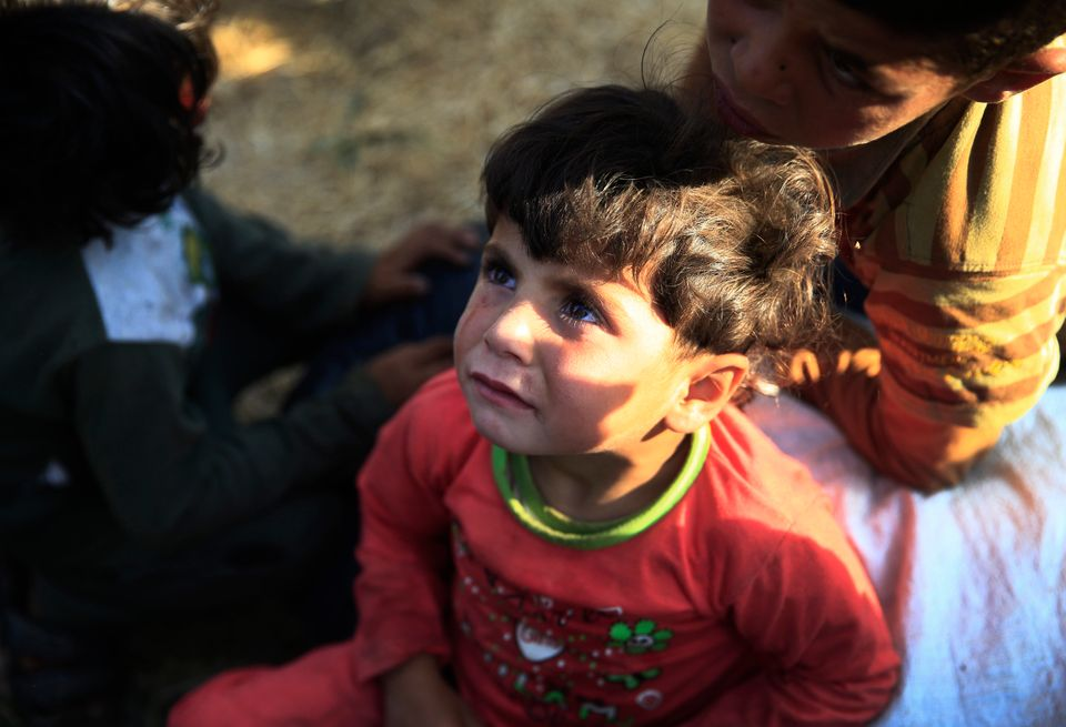 Syrian refugee children at the border fence after crossing into Turkey from Syria. (AP Photo/Lefteris Pitarakis)