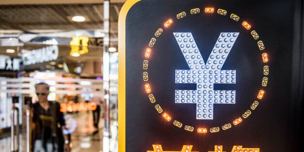 The currency symbol for the Chinese yuan is displayed at a currency exchange store in Hong Kong, China, on Wednesday, Aug. 12