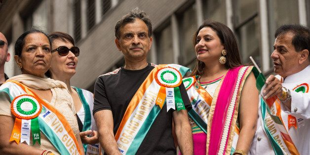 NEW YORK, NY - AUGUST 17: Vivek Ranadivé of the Sacramento Kings rides on the float during the India Day Parade on August 17