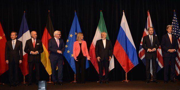 VIENNA, AUSTRIA - JULY 14: (R-L) US Secretary of State John Kerry, British Foreign Secretary Philip Hammond, Iran's Foreign M