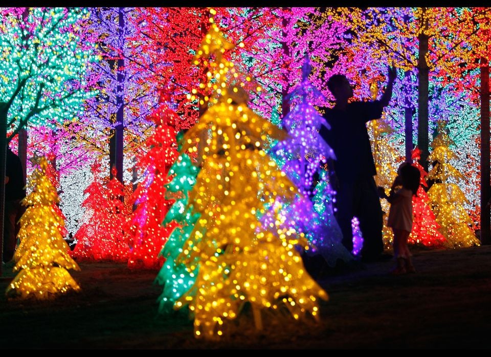 Malaysians admire light decorations ahead of Christmas, at i-City in Shah Alam outside Kuala Lumpur.