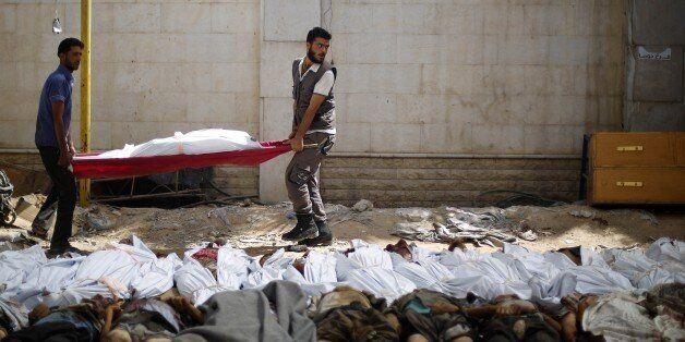DAMASCUS, SYRIA - AUGUST 16: Bodies of Syrians seen after Assad regime forces vacuum bomb air-strike staged to a marketplace