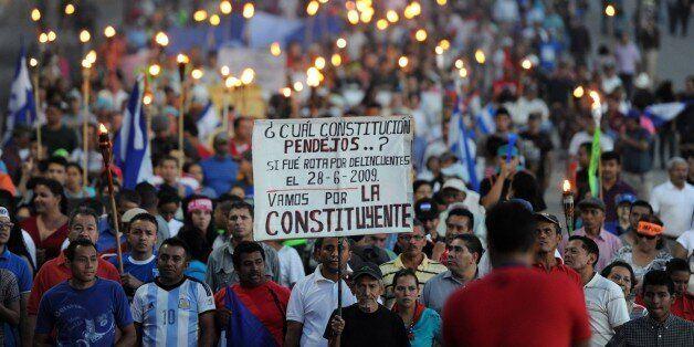 Demonstrators demanding the resignation of President Juan Orlando Hernandez over an ongoing corruption scandal demonstrate in