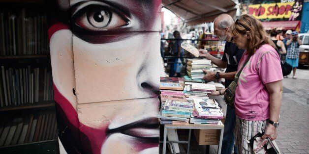 People look at second-hand books on sale at an Athens flee market on August  23, 2015. Greek opposition parties try to form a