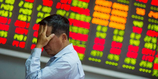 HAIKOU, CHINA - AUGUST 26:  (CHINA OUT) An investor reacts at a stock exchange hall on August 26, 2015 in Haikou, China. Chin
