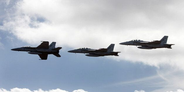 Royal Australian Air Force (RAAF) F/A-18F Super Hornet fighter jets manufactured by Boeing Co. fly in formation during the Au