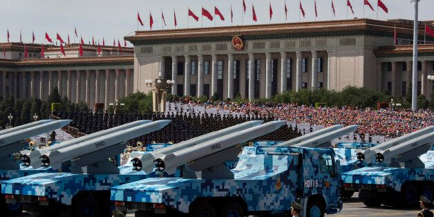 BEIJING, CHINA - SEPTEMBER 03:  Chinese missiles are seen on trucks as they drive next to Tiananmen Square and the Great Hall