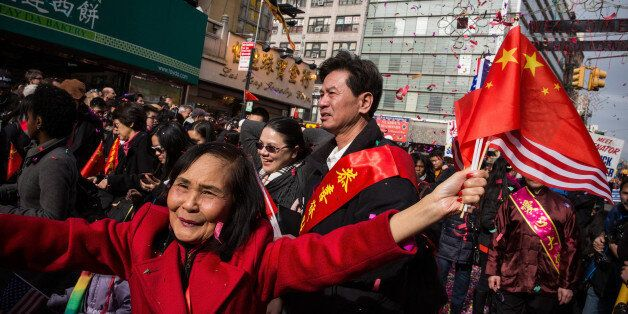 NEW YORK, NY - FEBRUARY 02:  People participate in the Chinese New Year Parade on February 2, 2014 in the Chinatown neighborh