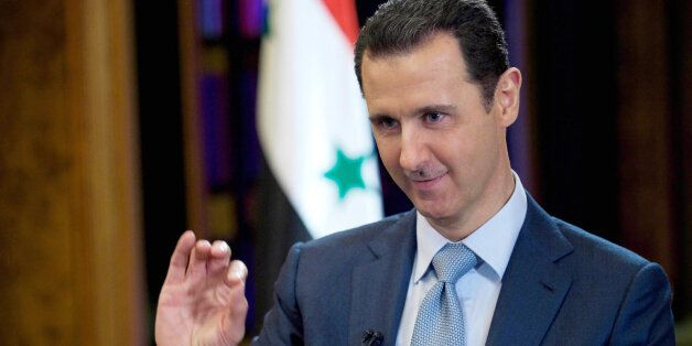 FILE - In this Tuesday, Feb. 10, 2015 file photo released by the Syrian official news agency SANA, Syrian President Bashar As