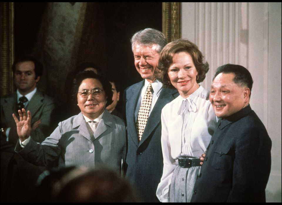 Chinese Vice Premier Deng Xiaoping, US First Lady Rosalynn Carter, US President Jimmy Carter and Deng's wife, smile Jan. 31,