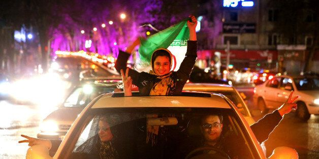 Iranians celebrate on a street in northern Tehran, Iran, Thursday, April 2, 2015, after Iran's nuclear agreement with world p